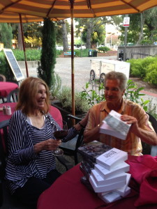 """The Idiot signing copies of """"The Idiot and the Odyssey II: Myth, Madness and Magic on the Mediterranean"""" in Sonoma County, California."""