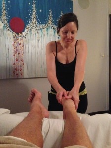 Massage therapist Crista Blackmore works on The Idiot's toes, tendons, muscles, ligaments and joints.