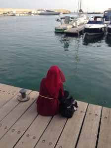 A young woman relaxes at the marina in Beirut.