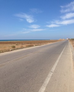 There was almost on traffic on the road and the coast near the seaside border between Lebanon and Syria.
