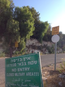 """These signs indicate that the road to the border is closed. """"Border Ahead No Entrance,"""" says one."""
