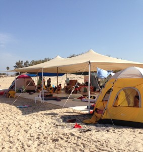 Tents on Israeli beaches provide a new definition of camping out --  or taking absolutely everything you own to the beach.