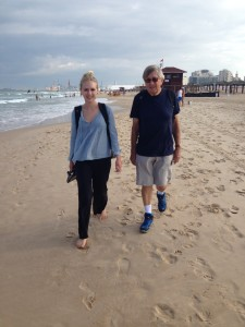 MedTrekker Sara Stratte, 21, and Michael Knipe, 76, strolling on the beach south of Ashdod, Israel.