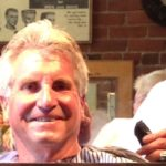 Mike Hernandez, The Idiot's barber in Redding, CA, whistles as he finishes a summer cut in his clip joint in the old Lorenz Hotel.