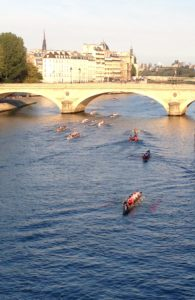 Boaters on the Seine at dawn.