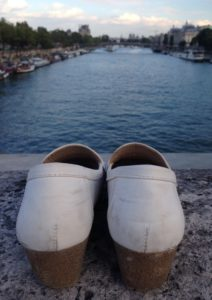 Wondering where the person is that left these shoes on the Pont de la Concorde over the Seine.